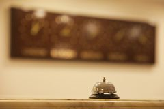 Old hotel bell on a wood stand. Old hotel bell on the wood stand royalty free stock photos