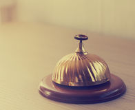 Old hotel bell on a wood stand Royalty Free Stock Photo
