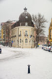 Old hotel in a snow-covered in Pomorie, Bulgaria, winter stock photography
