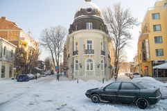 Old hotel on a snowy central square of Pomorie, Bulgaria Royalty Free Stock Images