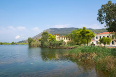 Old hotels at Kaiafas lake, western peloponnese - Greece. View of old hotels in the islet of Kaiafas lake at western peloponnese - Greece royalty free stock photo