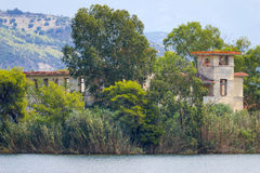 Old hotels at Kaiafas lake, western peloponnese - Greece. View of old hotels in the islet of Kaiafas lake at western peloponnese - Greece stock photos