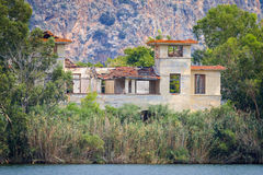 Old hotels at Kaiafas lake, western peloponnese - Greece. View of old hotels in the islet of Kaiafas lake at western peloponnese - Greece stock images