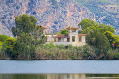 Old hotels at Kaiafas lake, western peloponnese - Greece. View of old hotels in the islet of Kaiafas lake at western peloponnese - Greece stock photo