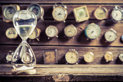 Old hourglass as the old way of timing. Closeup of old hourglass as the old way of timing stock photography