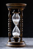 Old hourglass. On dark background Royalty Free Stock Image