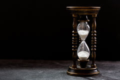 Old hourglass on dark background Royalty Free Stock Photography