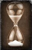Old Hourglass, vintage style, worn photo paper look image.  stock photography