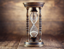 Old hourglass. On wooden background Stock Image