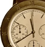 Old hours with a bronze dial. And the Roman figures Stock Image