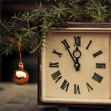 Old hours and Christmas toy. Royalty Free Stock Photos