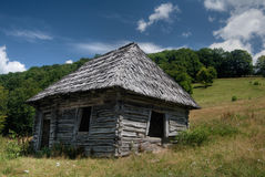 Old house. Old wooden lopsided house on slope of the hill Royalty Free Stock Photo