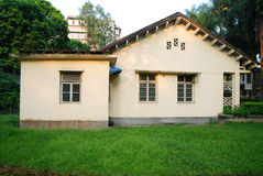 Old house. Old yellow house arounded by green grass Royalty Free Stock Images