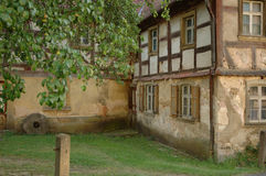 An old house. Very old german house with tree on foreground royalty free stock images
