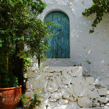 Old house. Traditional old house with blue arch door Stock Photos