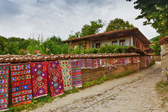 Old house. Traditional Bulgarian rugs on the streets of Zheravna Stock Image