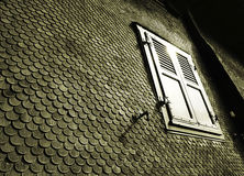 Old house. Sun reflected in the window of an old house, detail Royalty Free Stock Photo