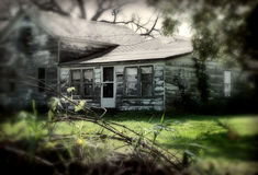 Old House. Old farm house, empty and rotting. Sharp focus on the farm house. I photoshopped in a bit of blurr and mood Stock Photography
