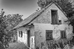 An old house abandoned. Village houses. Country house. In B/W Stock Photo
