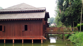 Old House above water in jungle. Very old house in Mini Malaysia and Asean Cultural Park Melaka Stock Photo
