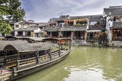 Old house along the river and Boat with black awning royalty free stock photo