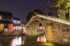 Old house along the river and Huanxiu bridge at night Royalty Free Stock Images