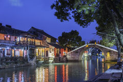 Old house along the river and Huanxiu bridge at night royalty free stock photo