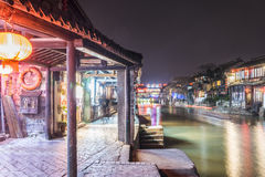 Old house along the river and Misty Rain gallery at night Stock Photos