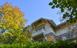 Old house with autumn trees stock image