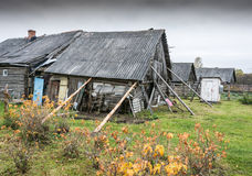 The old house. Back yard of an old house reinforced on two sides of the long poles stock image