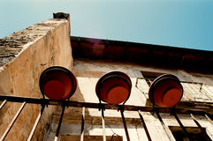 The old house with a balcony and flowerpots. Royalty Free Stock Image