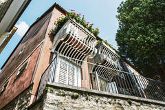 Old house with balcony and flowers, architectural theme Stock Images