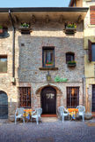 Old house and bar. Sirmione, Italy. Royalty Free Stock Photo