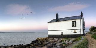 Old House on the Beach. Panorama of an old house on the beach at Lepe in the New Forest Royalty Free Stock Photography