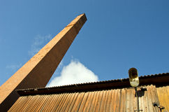 Old house with big red bricks chimney fragment Stock Image