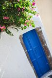 Old house and blue door at Emporio village of. Santorini island in Greece. See my other works in portfolio Royalty Free Stock Image