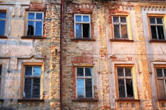 Old house with broken windows. The dilapidated old school building in Kourim royalty free stock photo