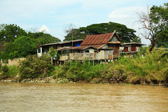 Old house build from zinc. Near the river Stock Photography