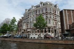 Old house on the canal in Amsterdam. AMSTERDAM, NETHERLANDS - MAY 13, 2017:Old house in the Baroque style on the canal in Amsterdam royalty free stock photography