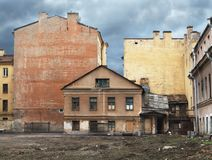 Old  house in city. Decrepit dwelling house on the building site Stock Photos