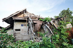 Old house collapsing from time. Stock Photo