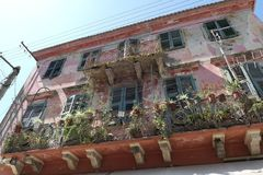 Old house in Corfu town with potted plants on balcony. Greece Stock Images