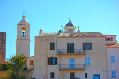 Old house of corsica under the sun. With church Stock Photo