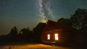 Old house in the countryside under the starry sky stock footage