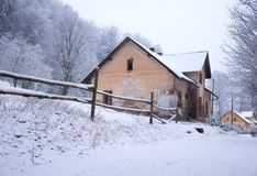 Old house covered in snow Royalty Free Stock Photos