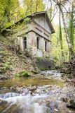 Old house with creek in forest Royalty Free Stock Photos
