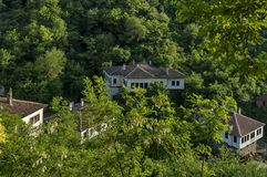 Old house crouched in forest at Melnik town Stock Photo