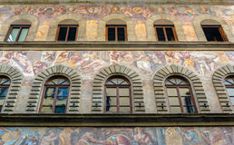 Old house, decorated with frescoes on the street in Florence Royalty Free Stock Photo