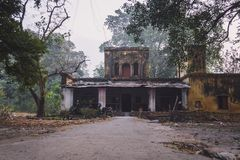 An Old House in Disrepair. Two-story old abandoned mansion. The house of a poor family Royalty Free Stock Images