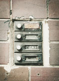Old house doorbells. A few old house doorbells in front of a brick wall stock photos